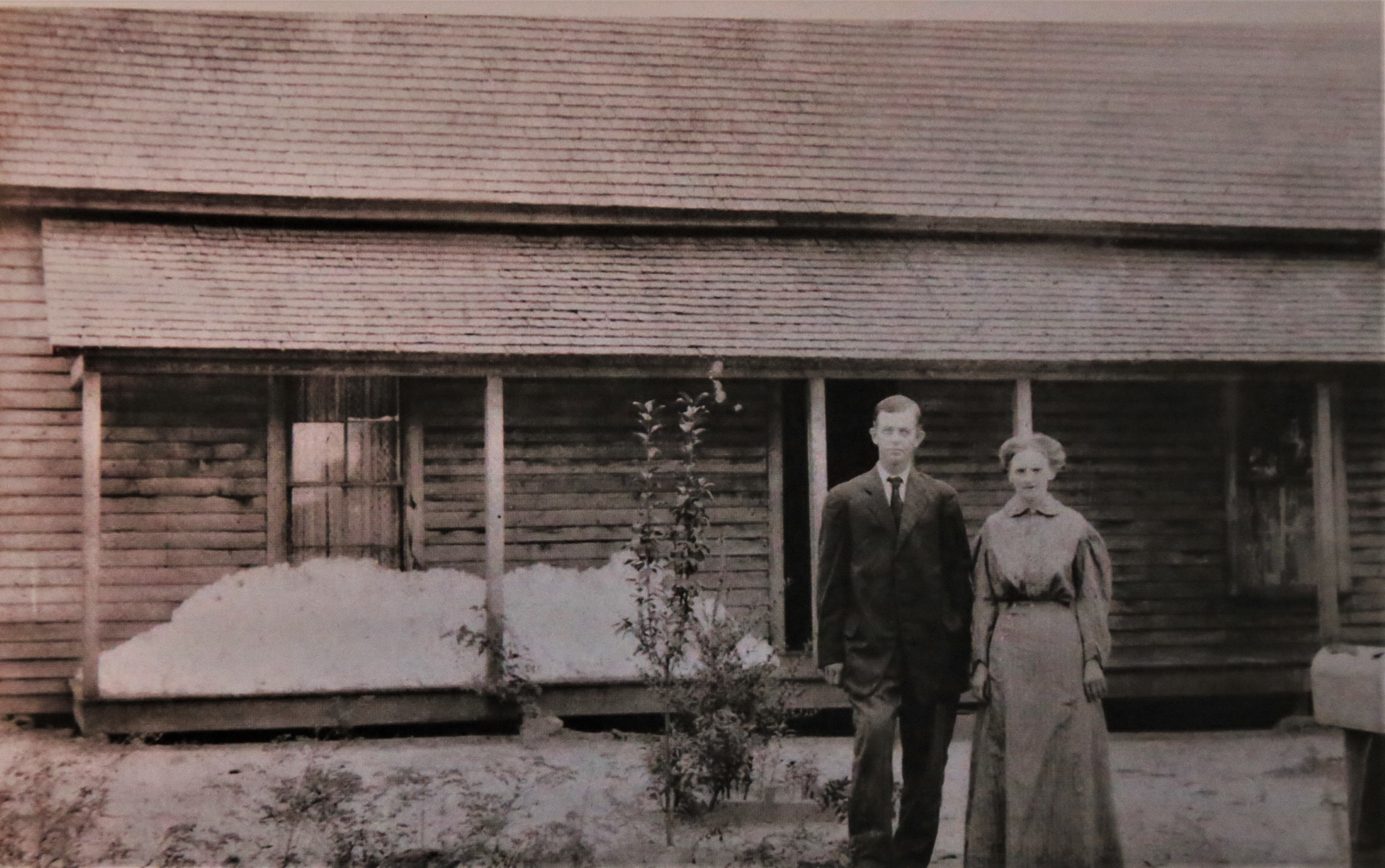 Buren and Bessie Wright Cowart store cotton on their front porch in Milton. (Photo courtesy Cowart family)